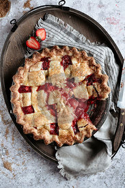A strawberry fruit pie with a lattice pastry crust
