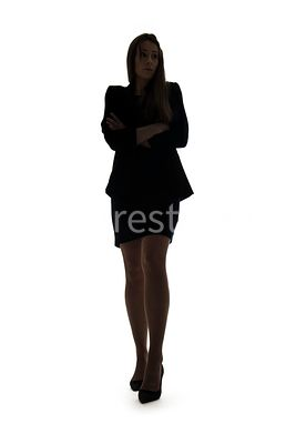 A silhouette, of a mystery woman in a suit – shot from low level.