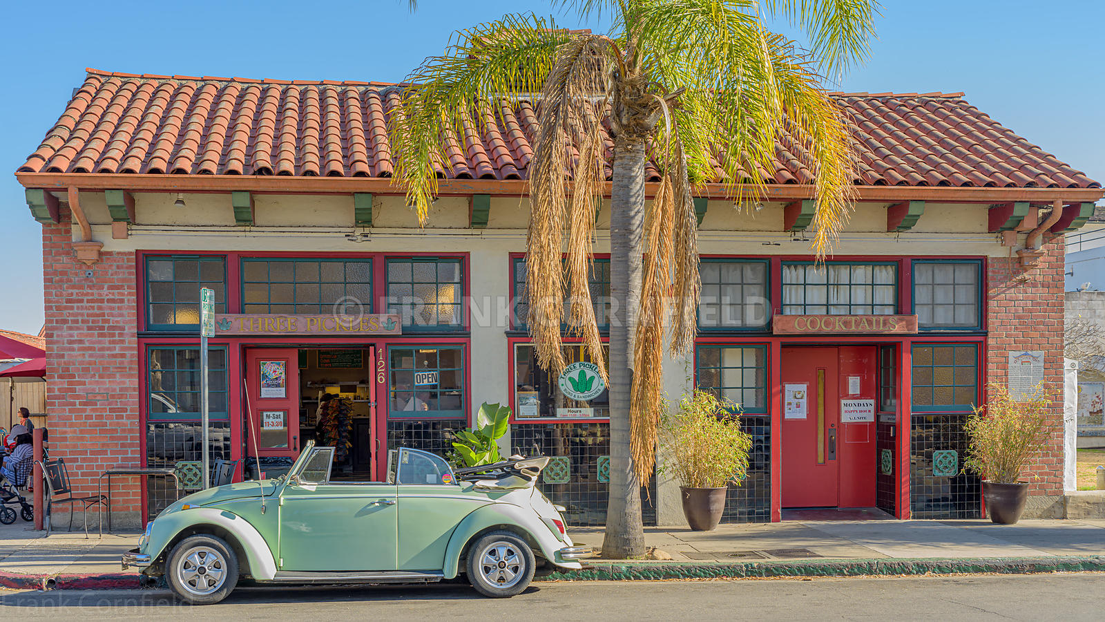 SANTA BARBARA, USA - FEBRUARY 07, 2018: The Three Pickles sandwich bar in Santa Barbara with a VW Beetle car parked outside.