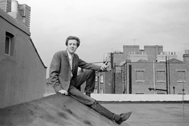#74853,  Cornelius Cardew, 1970,  Cornelius Cardew (1936-1981), avant-garde musician and composer, on the rooftops, Fitzrovia...