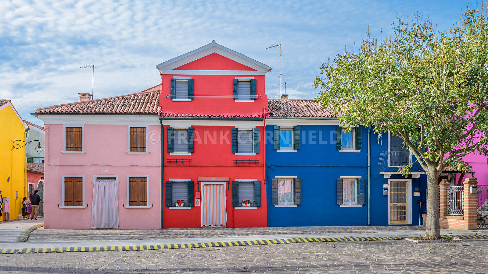 BURANO, ITALY - NOVEMBER 25, 2017: Beautiful coloured houses in Burano, Venice, Italy.
