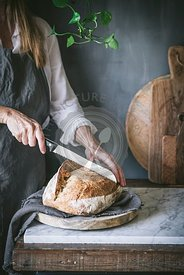 Homemade sourdough bread in a rustic kitchen