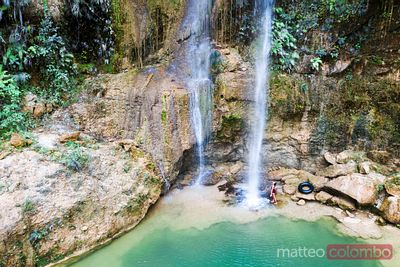 Woman standing near waterfall, Bohol, Philippines
