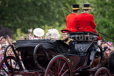 A Carriage carrying Prince Harry, Princess Catherine and Camilla, Duchess of Cornwall to the Trooping the Colour Ceremony in ...