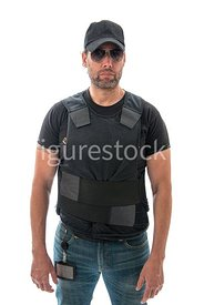 A Figurestock image of a cop /agent in a bullet proof vest and cap – shot from eye level.