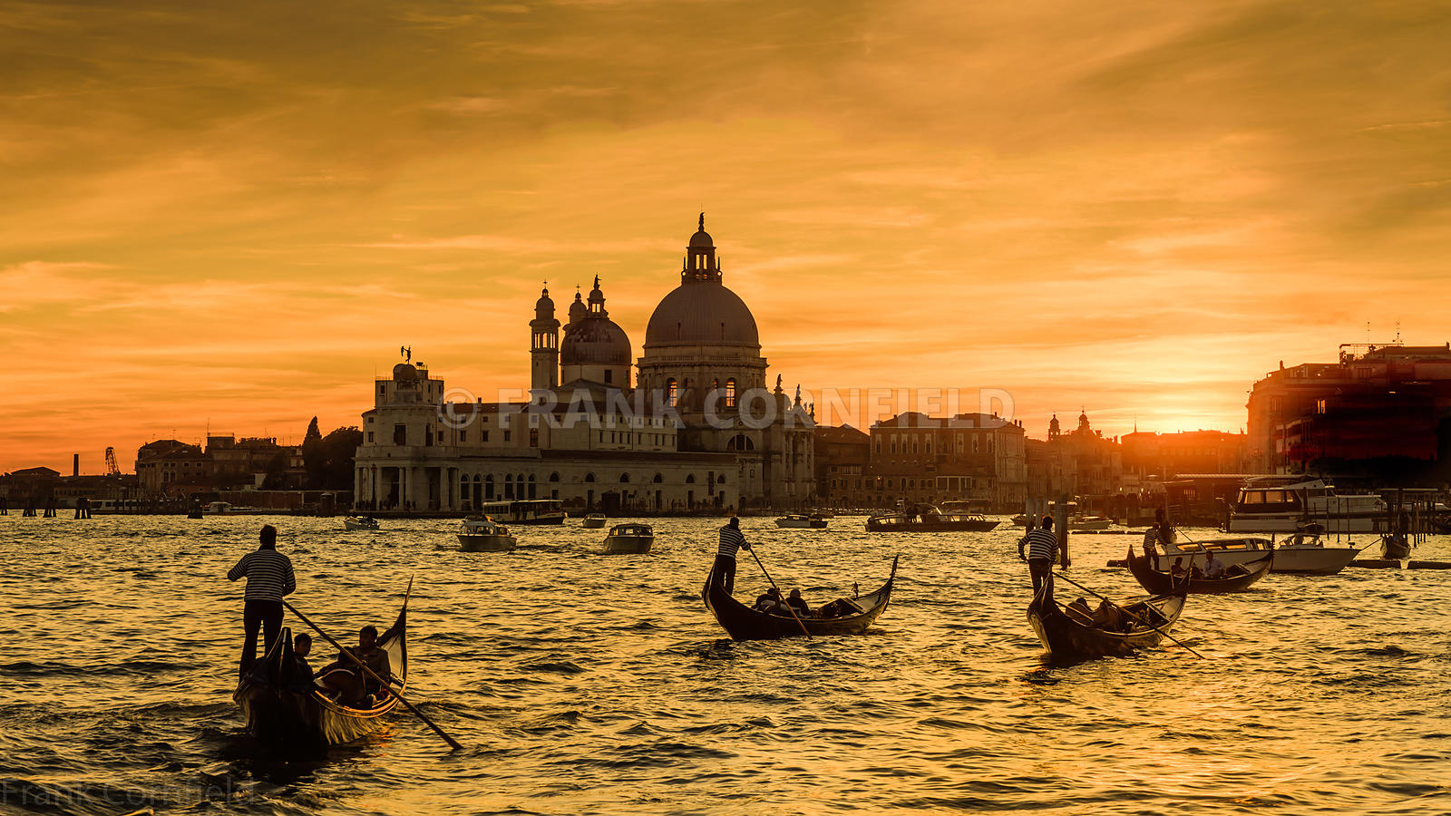 A classic Venice scene with gondolas on the Grand Canal near the Basilica Santa Maria della Salute, Venice.