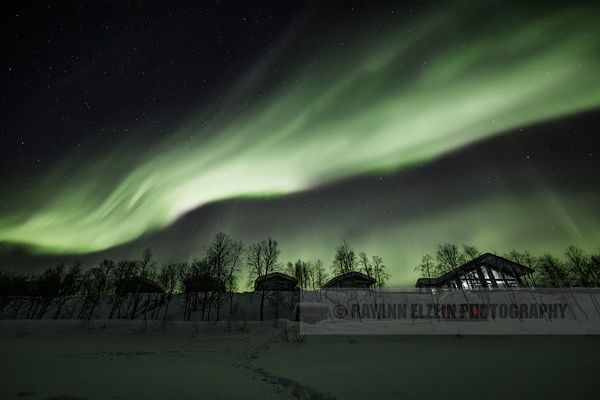Northern lights above cottages in Utsjoki in Lapland