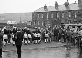 #77098,  The 'Nutters' Dance', Bacup, Lancashire,  1973.  On Easter Saturday every year the 'Coconut Dancers' gather at one b...