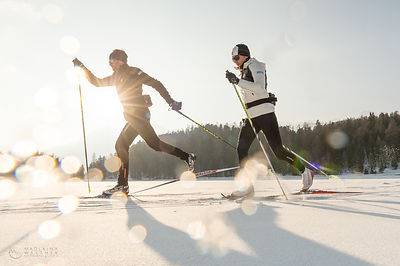 Two XC-skiers in the evening sun. Shot for Swiss Snowsports. Engadine, Switzerland.