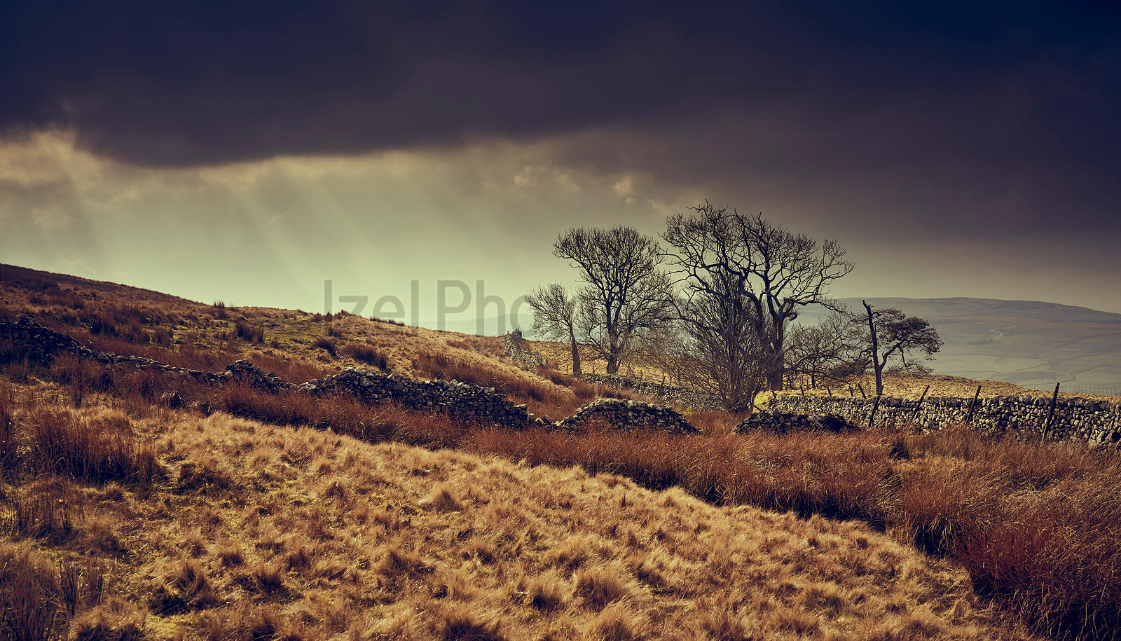 Dark storm clouds and rays of sunshine over the Yorkshire Dales
