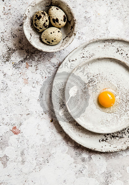 Quail eggs on grey ceramic plates