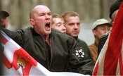 YZ46/15a National Front & BNP supporters heckle Irish Freedom march in commemoration of Bloody Sunday, Whitehall, London.