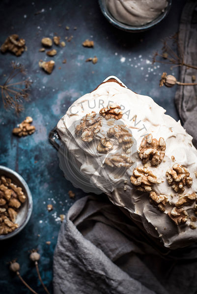 Carrot Loaf Cake With Cream Cheese Frosting Decorated With Walnuts