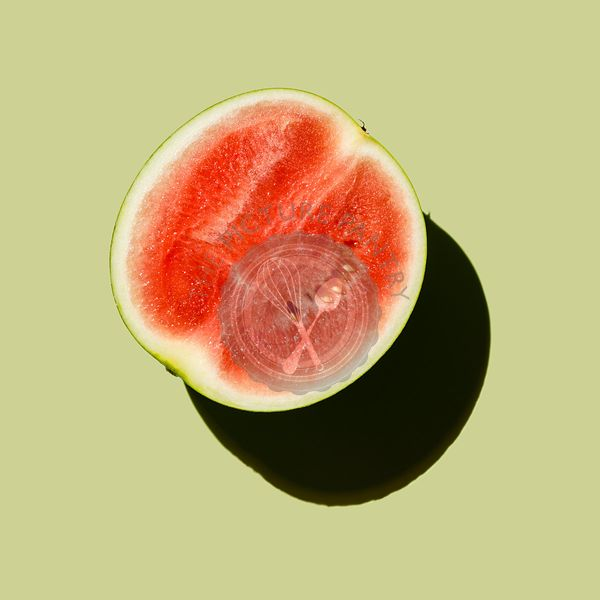 Fresh Watermelon cut in half on green background
