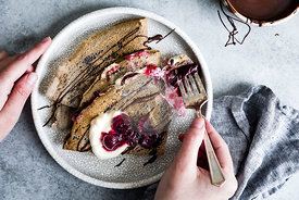 Toasty and nutty buckwheat crepes topped with roasted cherries, whipped cream, and bittersweet chocolate. A naturally gluten-...
