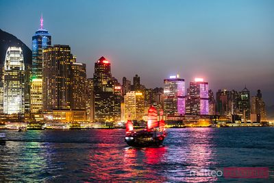 Hong Kong skyline and sailboat at night