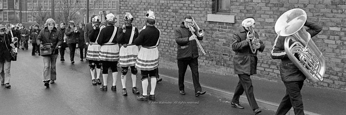 #77116,  The 'Nutters' Dance', Bacup, Lancashire,  1973.  On Easter Saturday every year the 'Coconut Dancers' gather at one b...