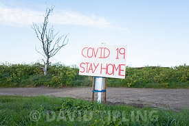 Covid - 19.  Sign at parking area opposite Cley Norfolk Wildlife Trust Reserve at Cley North Norfolk requesting people stay a...