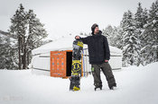 Manuel Lepir with his snowboard in front of a yurt. Maloja, Switzerland.