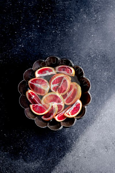 Blood oranges sliced in a bowl