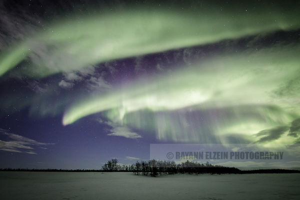 Strong aurora and clouds in Finnish Lapland