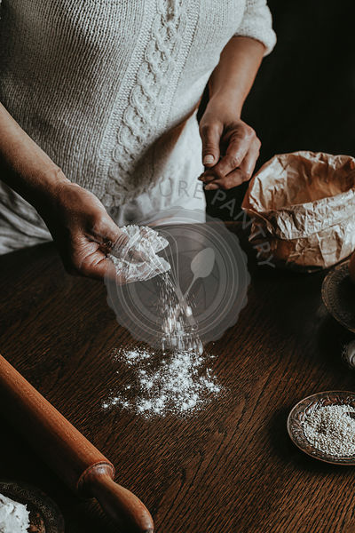 Sprinkling flour on a work surface