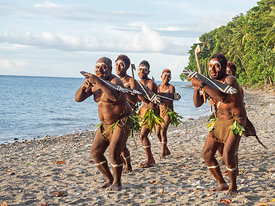 Savo Island men performing dance on the beach Savo Island, Solomon Islands, South Pacific