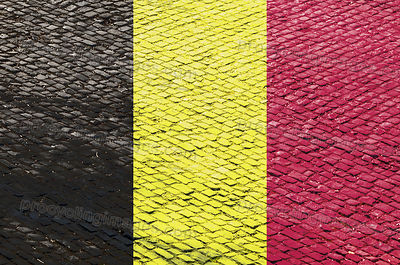 Belgian Flag on a Cobblestone Road Pattern