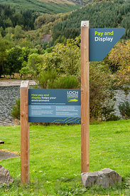 CALlANDER, SCOTLAND AUGUST 24, 2014: Parking signs at the Loch Lomond and Trossachs National Park site at Loch Lubnaig near C...