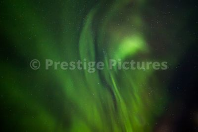 Close shot of the Aurora Borealis northern lights with stars clearly visible