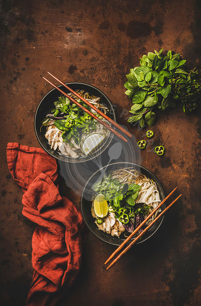 Vietnamese asian traditional rice noodle and chicken soup in bowls