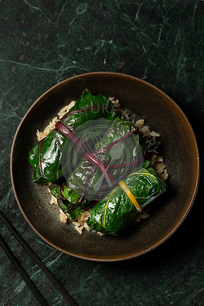 Japanese inspired rainbow chard rolls, filled with mushrooms and finished in a miso broth. They are served on  brown rice in ...