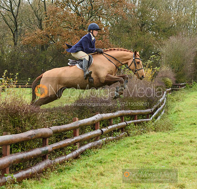 Emilie Chandler jumping a hedge at Orton Park - The Cottesmore Hunt at Knossington 26/11