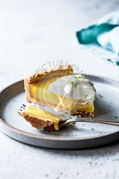 A lime tart on a ceramic plate