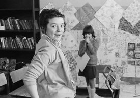 #75033  Decorating the walls with pages from a wallpaper catalogue, Liverpool Free School, Liverpool  1971.  Also known as th...