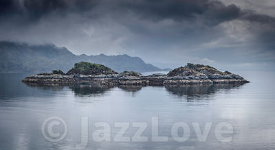 Moody sky above Loch Eilt with islands.Beautiful landscape of Scotland ,UK.
