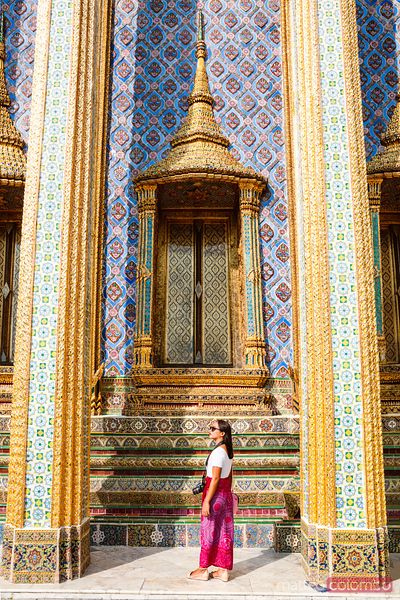 Female tourist visiting the Wat Phra Kaew, Bangkok, Thailand