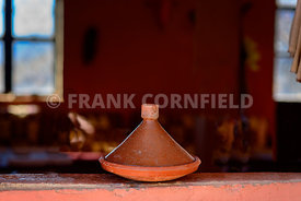 A Moroccan tajine on winfow sill of a rural cafe in Morocco.