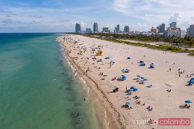 Aerial view of South beach crowded with tourists at daytime