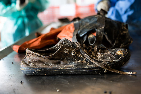 During the analysis of the clothes, the only shoe of one of the victims