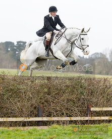 Willie Reardon jumping a hedge near the meet