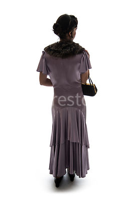 A Figurestock silhouette of a vintage 1920s - 1930s woman in a pink dress and fur, looking away – shot from eye level.