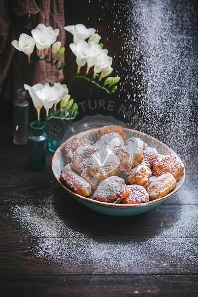 Sweet fritters dusted with powdered sugar