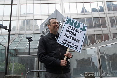 NUJ General Secretary, Jeremy Dear, stages a one-man protest outside the headquarters of the Metropolitan Police