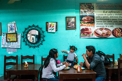 An indigenous family eat at a cafe