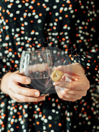 Taralli or tarallini and wine glass in female hands