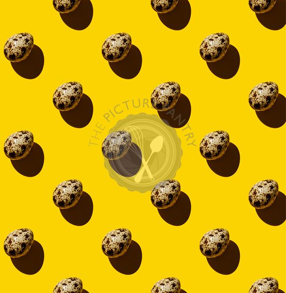 Quail egg on yellow background Pattern
