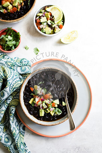 Black beans with avocado, tomato, red onion and cilantro.
