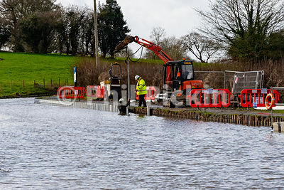 Engineers at work on the canal towpath
