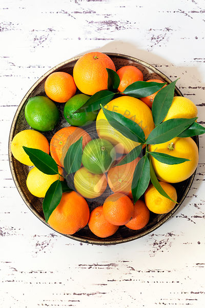 Citrus on a ceramic plate.